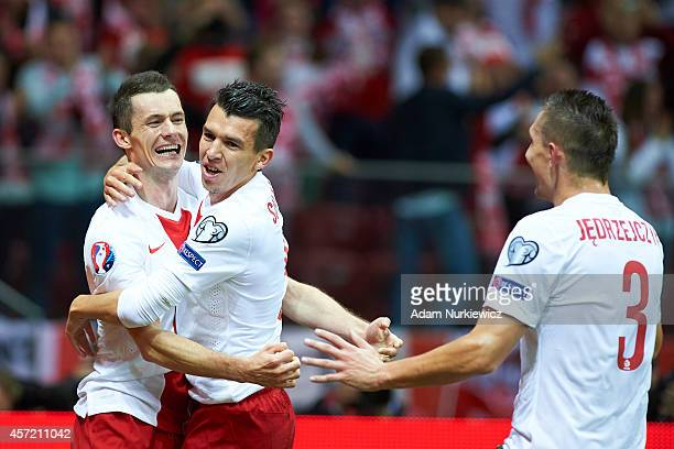 Poland's Krzysztof Maczynski celebrates with teammates after scoring during the UEFA EURO 2016 qualifying match between Poland and Scotland on...