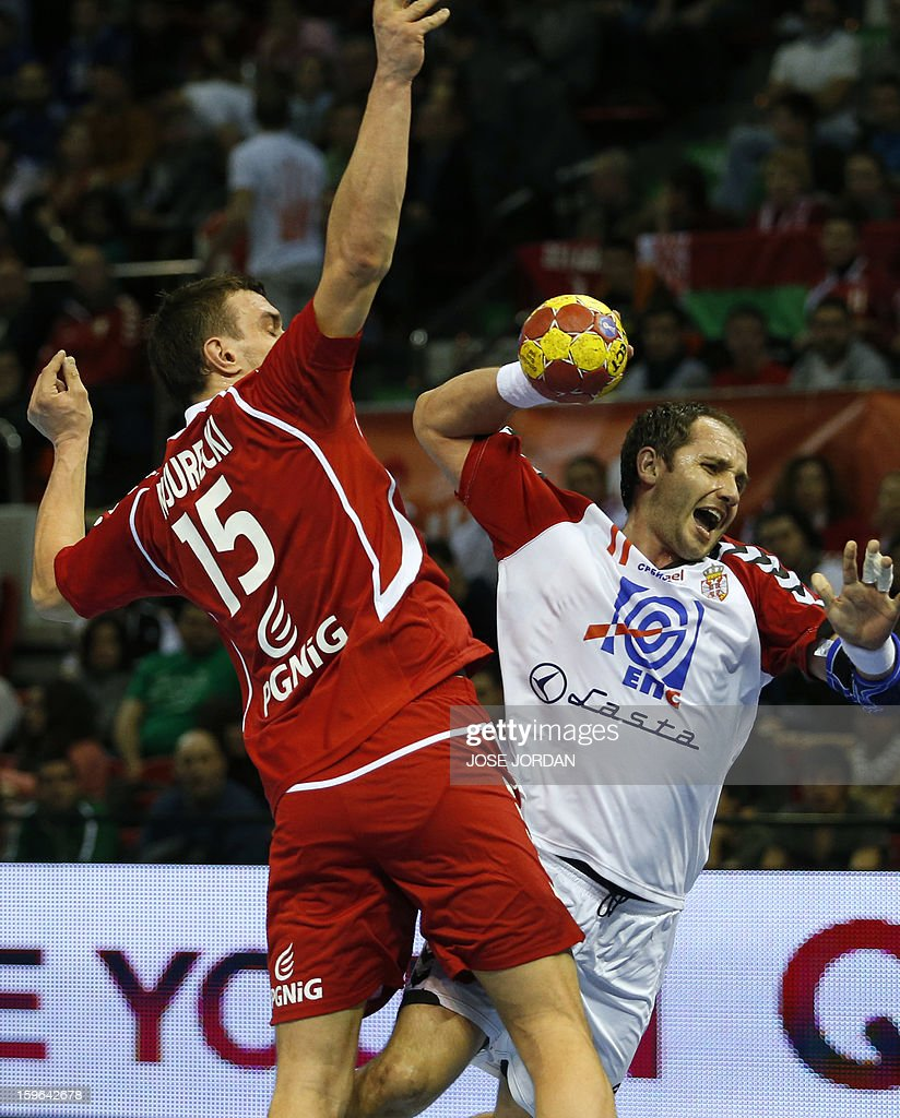Poland's left back Michal Jurecki (L) vies with Serbia's pivot Alem Toskic during the 23rd Men's Handball World Championships preliminary round Group C match Poland vs Serbia at the Pabellon Principe Felipe in Zaragoza on January 17, 2013.