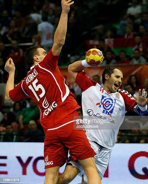 Poland's left back Michal Jurecki vies with Serbia's pivot Alem Toskic during the 23rd Men's Handball World Championships preliminary round Group C...