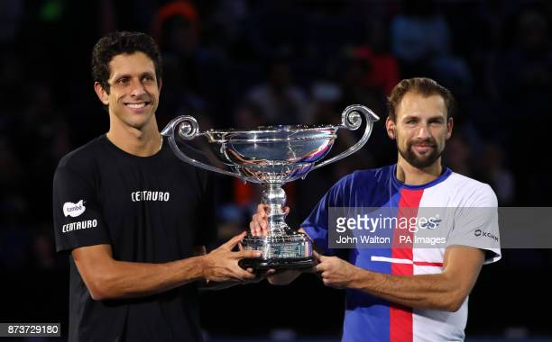 Poland's Lukasz Kubot and Brazil's Marcelo Melo are presented with a trophy after finishing the year as the number one ranked doubles team during day...