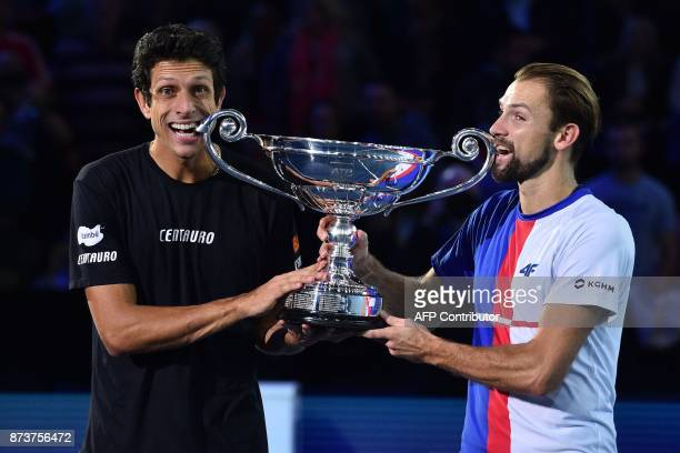 Poland's Lukasz Kubot and his partner Brazil's Marcelo Melo pose with the 2017 ATP World Tour Doubles Champions trophy after their win over Croatia's...