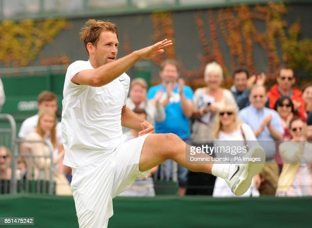 Poland's Lukasz Kubot celebrates defeating France's Adrian Mannarino after winning their match during day seven of the Wimbledon Championships at The...