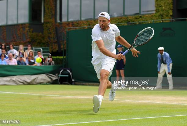 Poland's Lukasz Kubot in action against France's Adrian Mannarino during day seven of the Wimbledon Championships at The All England Lawn Tennis and...