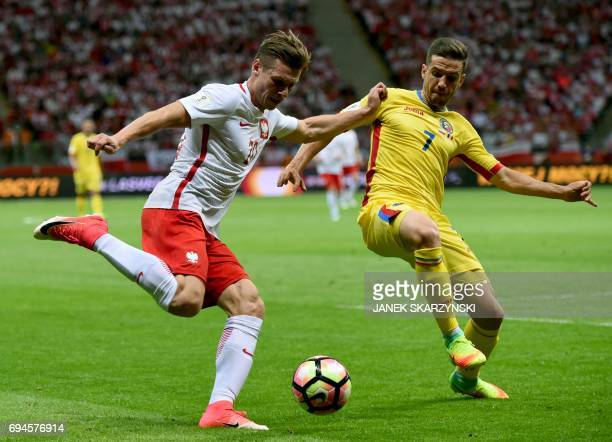 Poland's Lukasz Piszczek and Romania's Alexandru Chipciu vie for the ball during the FIFA World Cup 2018 qualification football match between Poland...