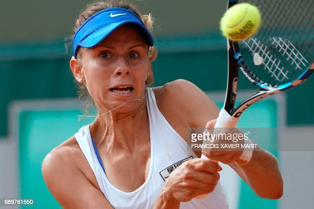 Poland's Magda Linette returns the ball to France's Alize Lim during their tennis match at the Roland Garros 2017 French Open on May 29 2017 in Paris...