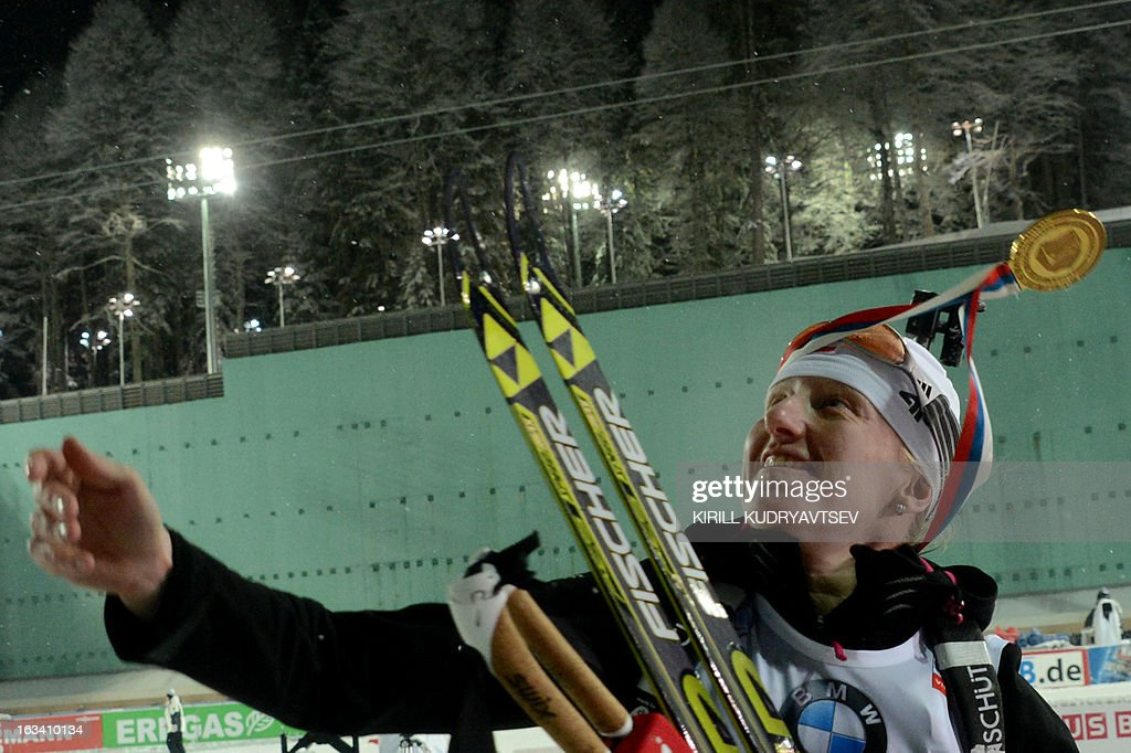 Poland's Magdalena Gwizdon celebrates her first place in Women 7.5 km Sprint during IBU World Cup Biathlon at Laura Cross Country and Biathlon Centre in the Russian Black Sea resort of Sochi on March 9, 2013. Gwizdon took the first place ahead of Slovakia's Anastasiya Kuzmina and Norway's Tora Berger. AFP PHOTO/KIRILL KUDRYAVTSEV