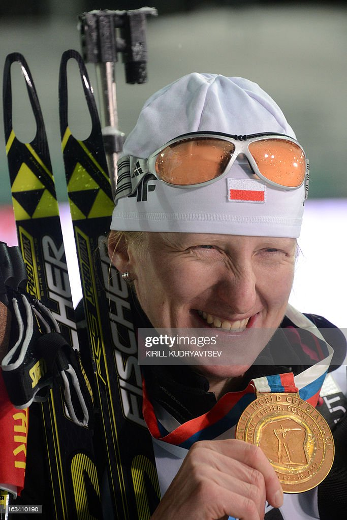 Poland's Magdalena Gwizdon celebrates her first place in Women 7.5 km Sprint during IBU World Cup Biathlon at Laura Cross Country and Biathlon Centre in the Russian Black Sea resort of Sochi on March 9, 2013. Gwizdon took the first place ahead of Slovakia's Anastasiya Kuzmina and Norway's Tora Berger.