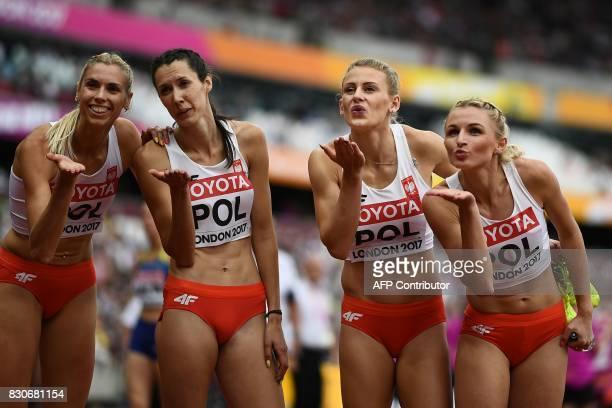 Poland's Malgorzata Holub Patrycja Wyciskiewicz Poland's Martyna Dabrowska and Poland's Iga Baumgart poses after the women's 4x400m relay athletics...