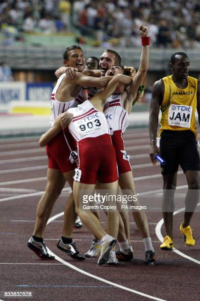 Poland's Marek Plawgo Daniel Dabrowski Marcin Marciniszyn and Kacper Kozlowski celebrate winning bronze in the 4x400 metre relay