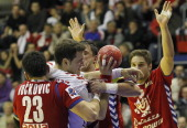 Poland's Mariusz Jurkiewicz in action against Serbia's Nenad Vuckovic and Momir Ilic during the Men's European Handball Championship group A match...