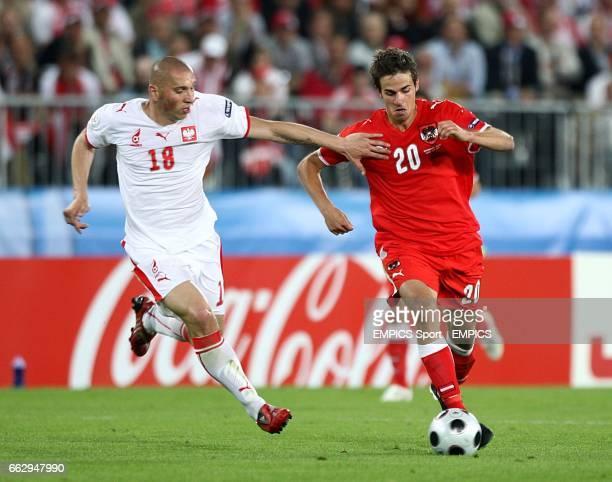 Poland's Mariusz Lewandowski and Austria's Martin Harnik battle for the ball