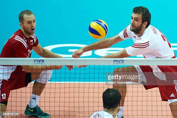 Poland's Mateusz Mika receives the ball during the FIVB World Championships Final match between Brazil and Poland at Spodek Hall on September 21 2014...