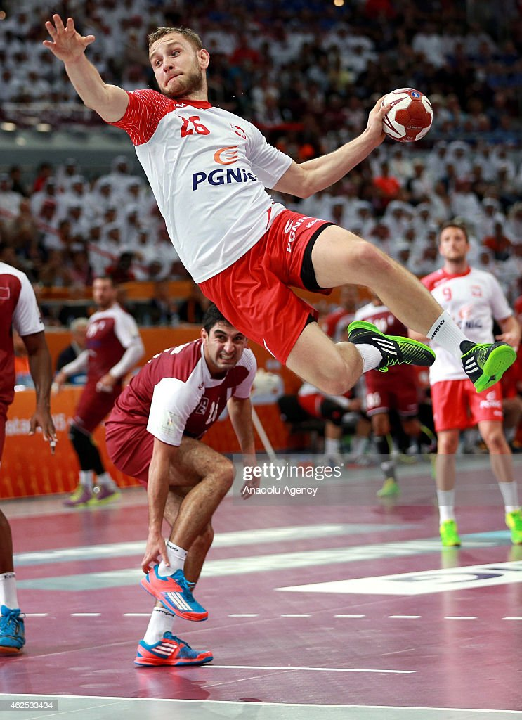Poland's Michal Daszek (C) in action during the 24th Men's Handball World Championships semifinal handball match between Poland and Qatar at the Lusail Sports Arena in Doha, Qatar on January 30, 2015.