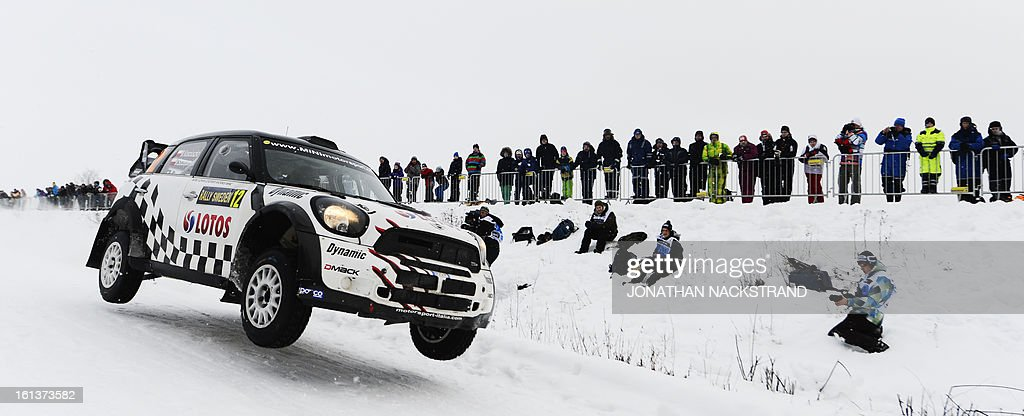 Poland's Michal Kosciuszko and his co-driver Maciej Szczepaniak steer their Mini John Cooper Works WRC during Kirkenaer stage, the 19th of Rally Sweden, second round of the FIA World Rally Championship on February 10, 2013 in Kirkenaer, Norway.