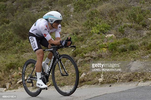 Poland's Michal Kwiatkowski wearing the best young's white jersey competes during the 95 km individual timetrial and last stage of the 73rd edition...