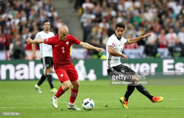 Poland's Michal Pazdan and Germany's Sami Khedira battle for the ball
