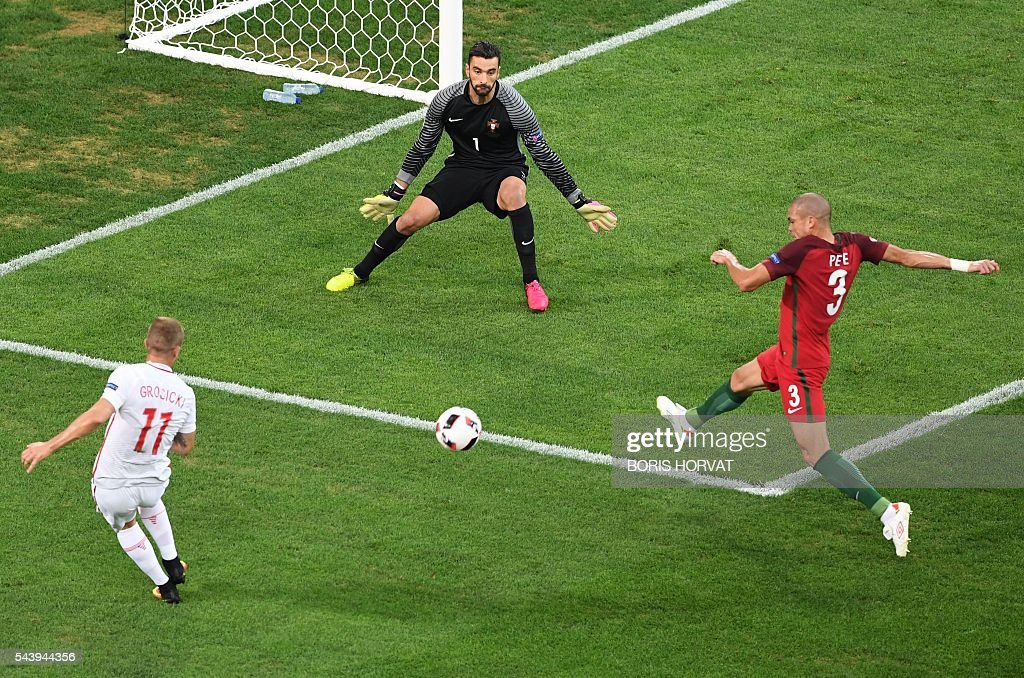 Poland's midfielder Kamil Grosicki (L) kicks the ball next to Portugal's goalkeeper Rui Patricio and Portugal's defender Pepe during the Euro 2016 quarter-final football match between Poland and Portugal at the Stade Velodrome in Marseille on June 30, 2016. / AFP / BORIS