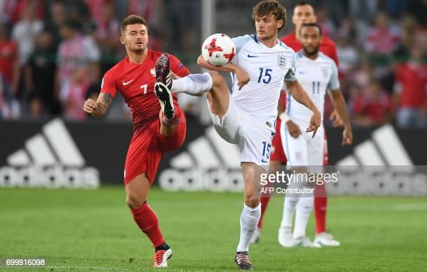 Poland's midfielder Karol Linetty and England's midfielder John Swift vie for the ball during the UEFA U21 European Championship Group A football...