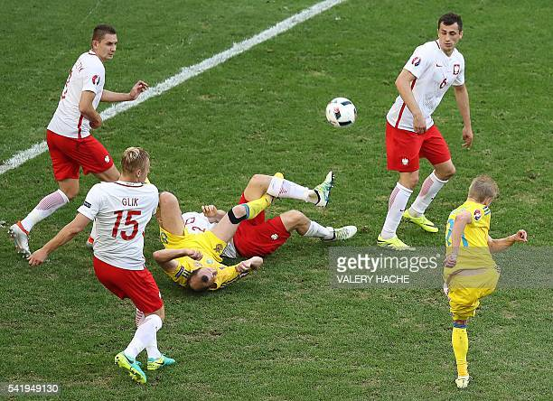Poland's midfielder Karol Linetty vies with Ukraine's forward Roman Zozulya during the Euro 2016 group C football match between Ukraine and Poland at...