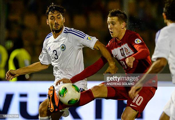 Poland's midfielder Piotr Zielinski fights for the ball witht San Marino's defender Mirko Palazzi during the FIFA World Cup 2014 qualifying football...