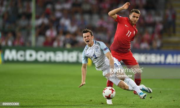 Poland's midfielder Przemyslaw Frankowski and England's midfielder Ben Chilwell vie for the ball during the UEFA U21 European Championship Group A...