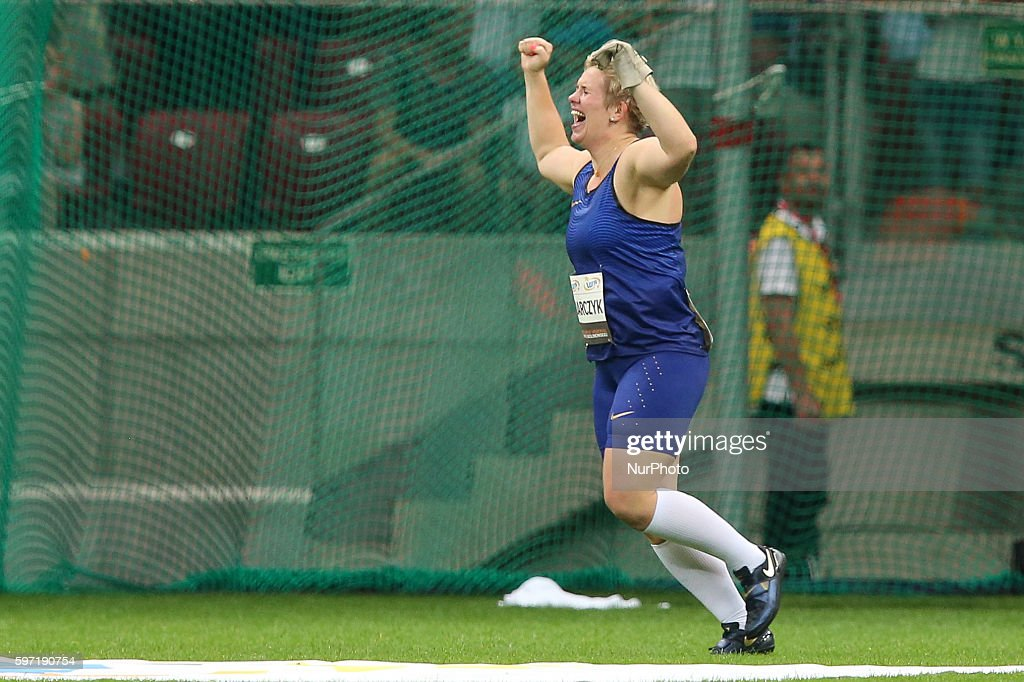 Poland's Olympic champion Anita Wlodarczyk celebrates after breaking her own world record in the Women's Hammer Throw during the athletics meeting of...