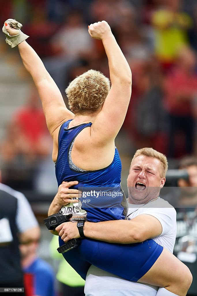 Poland's Olympic champion Anita Wlodarczyk celebrates with her coach Krzysztof Kliszewski after breaking her own world record in the Women's Hammer...