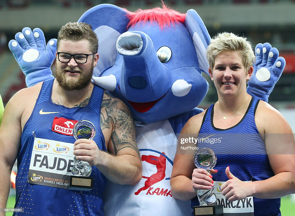 Poland's Olympic champion Anita Wlodarczyk pose with Pael Fajdek after breaking her own world record in the Women's Hammer Throw during the athletics...