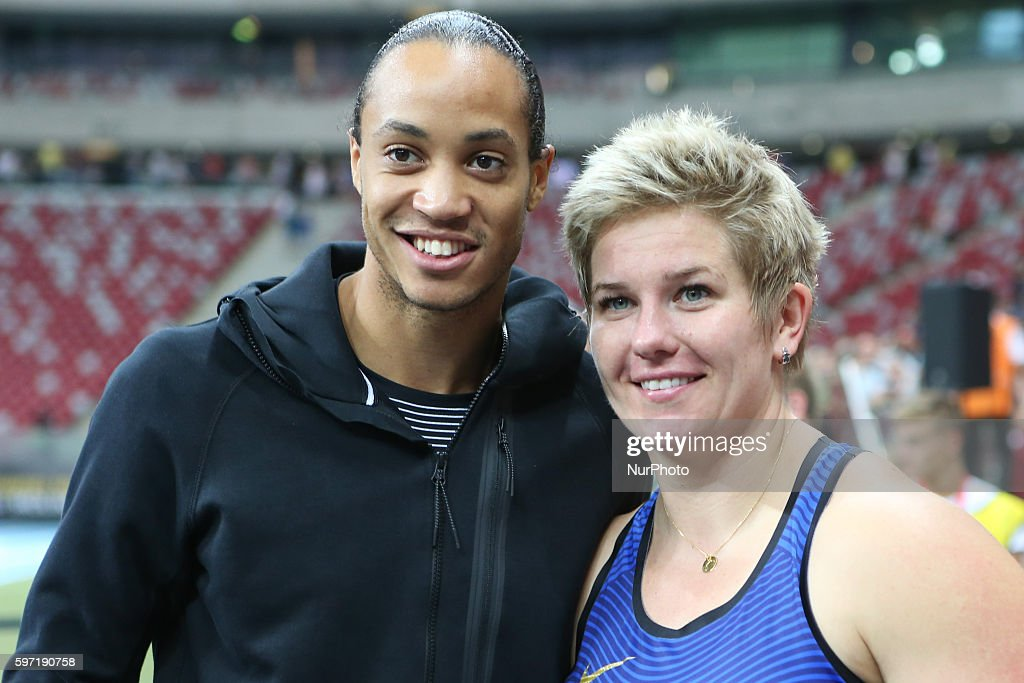 Poland's Olympic champion Anita Wlodarczyk pose with Pascal MartinotLagarde after breaking her own world record in the Women's Hammer Throw during...