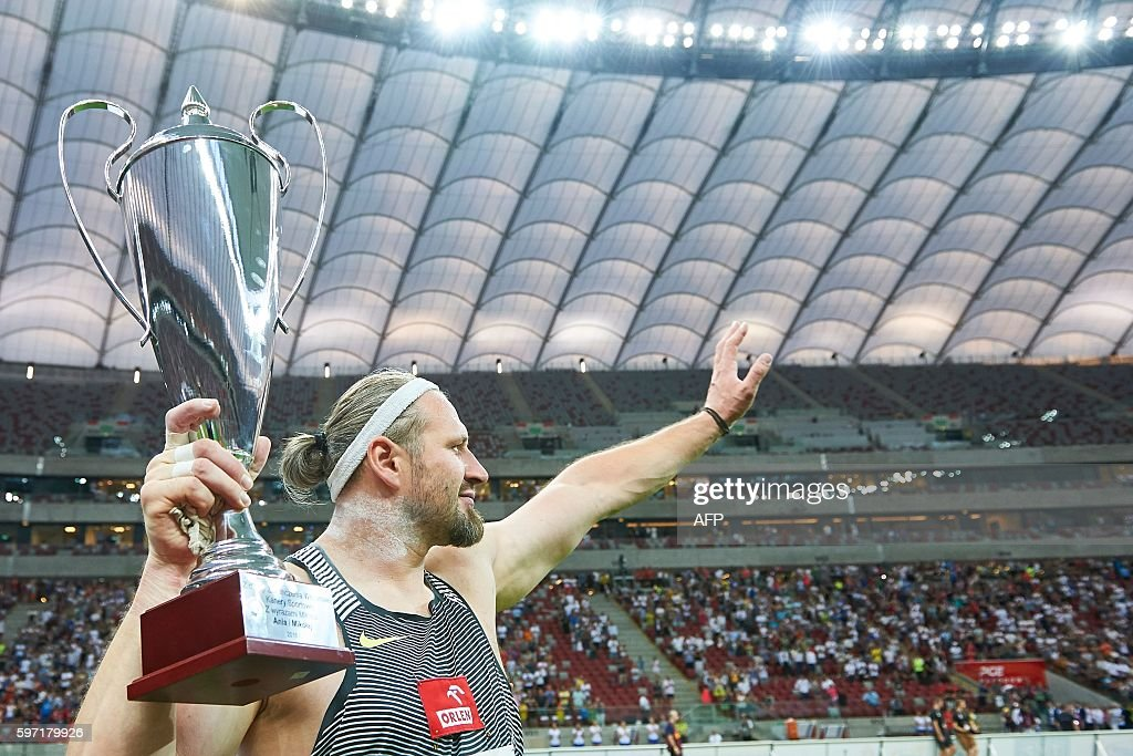 Poland's olympic champion Tomasz Majewski says goodbye to the Polish audience after the Men's Shot Put competition during the athletics meeting of...