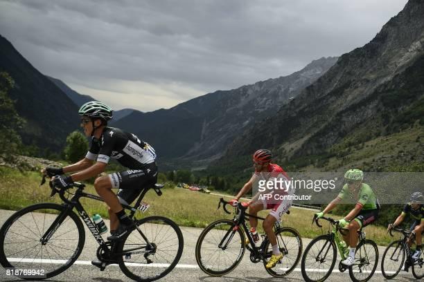 Poland's Pawel Poljanski Spain's Daniel Navarro and Switzerland's Michael Albasini ride in a breakaway during the 183 km seventeenth stage of the...