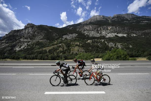 Poland's Pawel Poljanski Switzerland's Michael Schar and France's Sylvain Chavanel ride during the 1795 km eighteenth stage of the 104th edition of...