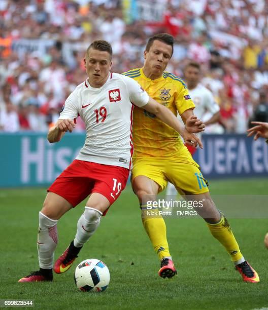 Poland's Piotr Zielinski and Ukraine's Yevhen Konoplyanka battle for the ball