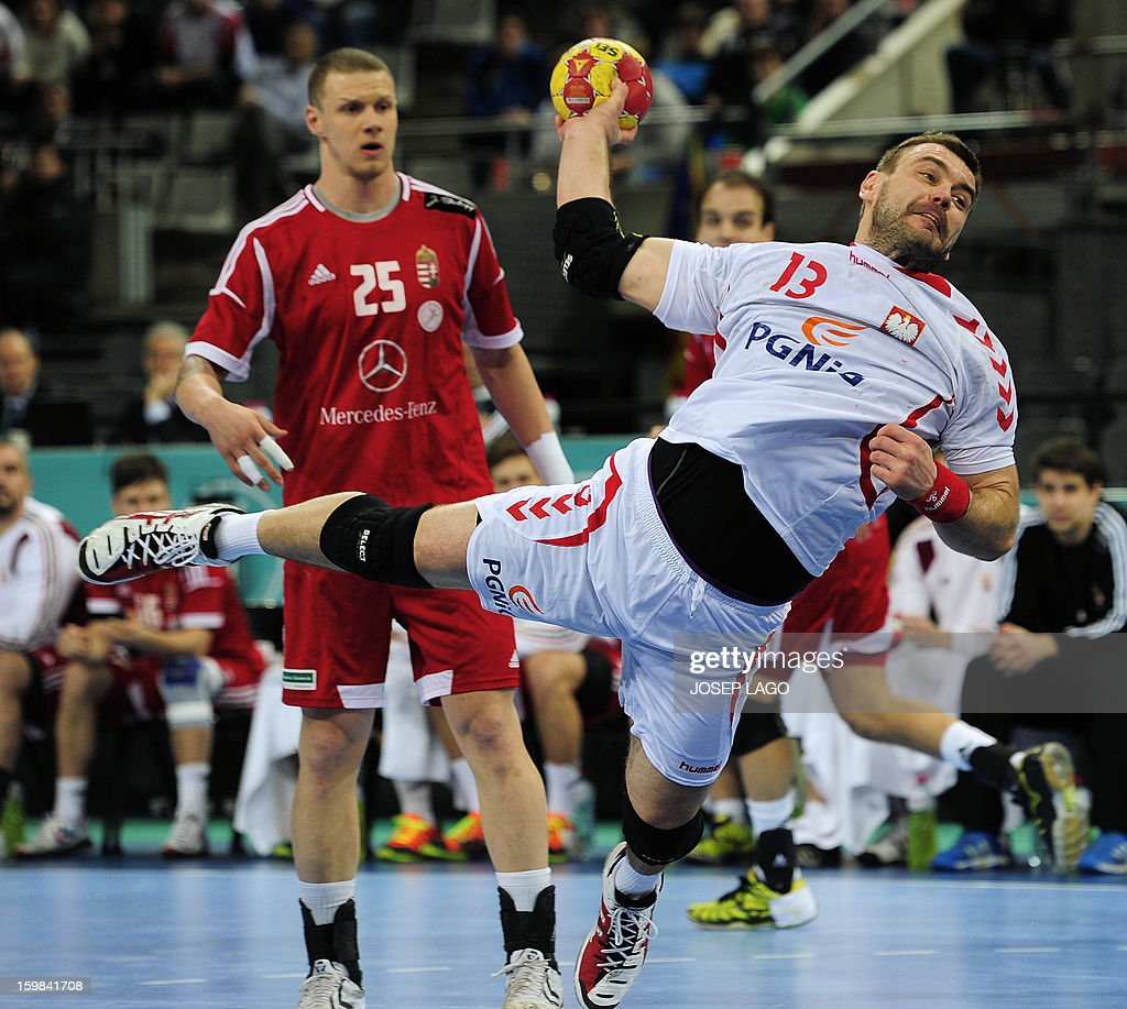 Poland's pivot Bartosz Jurecki scores during the 23rd Men's Handball World Championships round of 16 match Hungary vs Poland at the Palau Sant Jordi in Barcelona on January 21, 2013.