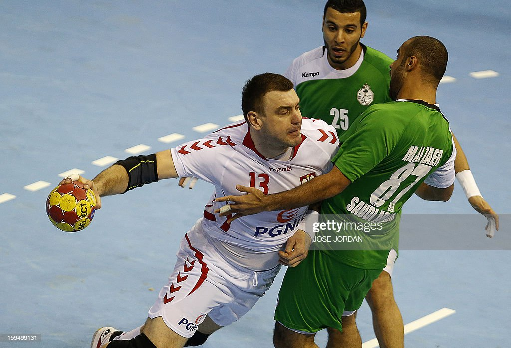 Poland's pivot Bartosz Jurecki (L) vies with Saudi Arabia's rightback Abdullah Alhammad and Saudi Arabia's leftback Mohammed Alzaer (R) during the 23rd Men's Handball World Championships preliminary round Group C match Saudi Arabia vs Poland at the Pabellon Principe Felipe in Zaragoza on January 14, 2013.