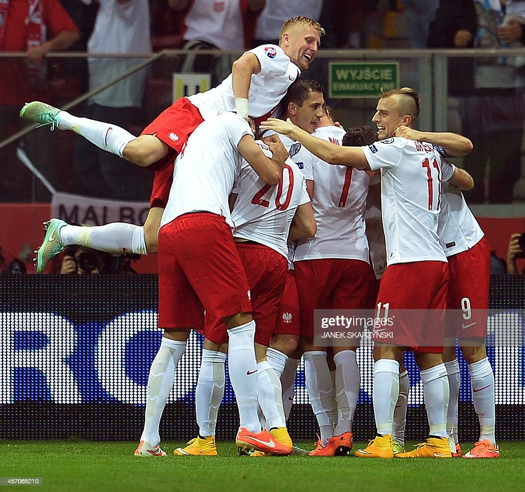 Poland's players celebrate after scoring the 10 against Germany during the Euro 2016 Group D qualifying football match Poland vs Germany in Warsaw...