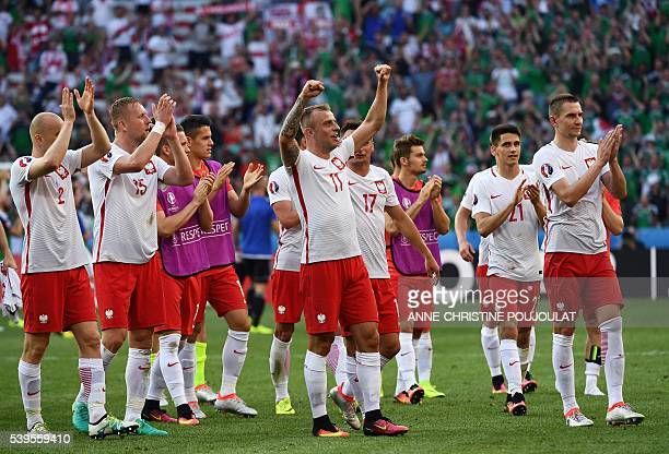 Poland's players celebrate their victory at the end of the Euro 2016 group C football match between Poland and Northern Ireland at the Stade de Nice...