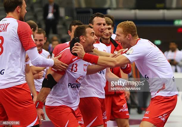 Poland's players Poland's Bartosz Jurecki and Poland's Karol Bielecki celebrate after winning their 24th Men's Handball World Championships...