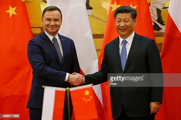 Poland's President Andrzej Duda and his Chinese counterpart Xi Jinping shake hands after a signing ceremony following their meeting at the Great Hall...
