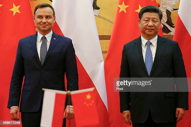 Poland's President Andrzej Duda and his Chinese counterpart Xi Jinping take a podium before a signing ceremony following their meeting at the Great...