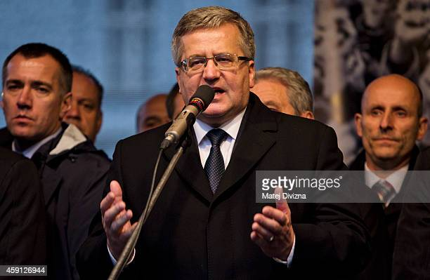 Poland's President Bronislaw Komorowski speaks before the unveiling of a plaque on the 25th anniversary of the Velvet Revolution on November 17 2014...