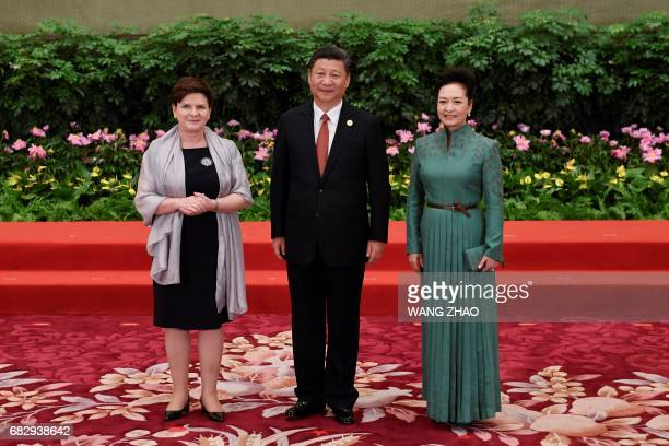 Poland's Prime Minister Beata Szydlo poses with Chinese President Xi Jinping and his wife Peng Liyuan during a welcome ceremony for leaders attending...