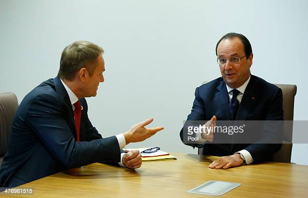 Poland's Prime Minister Donald Tusk and France's President Francois Hollande speak during a meeting to discuss the situation in Ukraine at the...