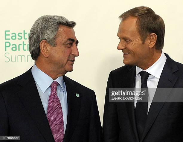 Poland's Prime Minister Donald Tusk speaks with Armenia's President Serzh Sargsian before an opening dinner of the Eastern Partnership summit on...