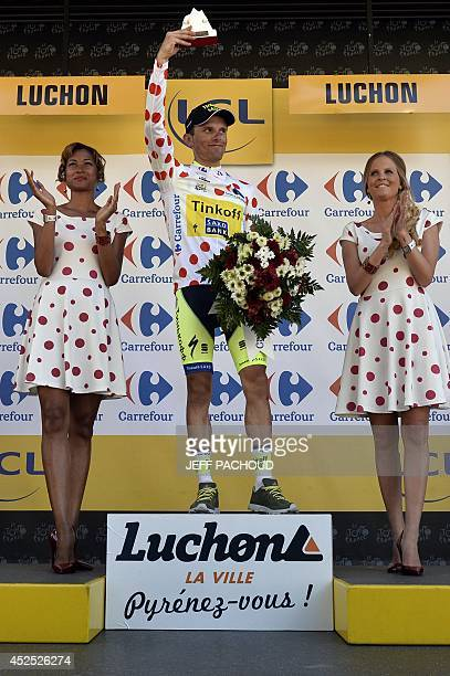 Poland's Rafal Majka celebrates his polka dot jersey of best climber on the podium at the end of the 2375 km sixteenth stage of the 101st edition of...