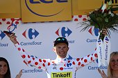 Poland's Rafal Majka celebrates his polka dot jersey on the podium at the end of the 160 km fifteenth stage of the 103rd edition of the Tour de...