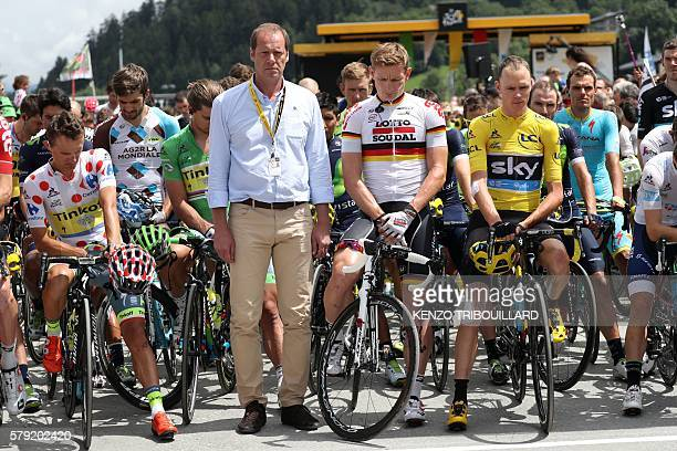 Poland's Rafal Majka wearing the best climber's polka dot jersey General director of the Tour de France Christian Prudhomme Germany's Andre Greipel...