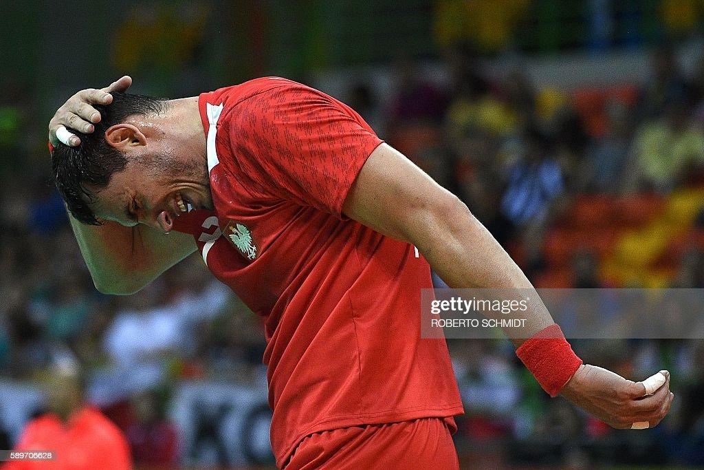 Poland's right back Krzysztof Lijewski reacts during the men's preliminaries Group B handball match Poland vs Slovenia for the Rio 2016 Olympics...