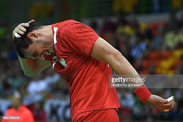 Poland's right back Krzysztof Lijewski reacts during the men's preliminaries Group B handball match Poland vs Slovenia for the Rio 2016 Olympics...