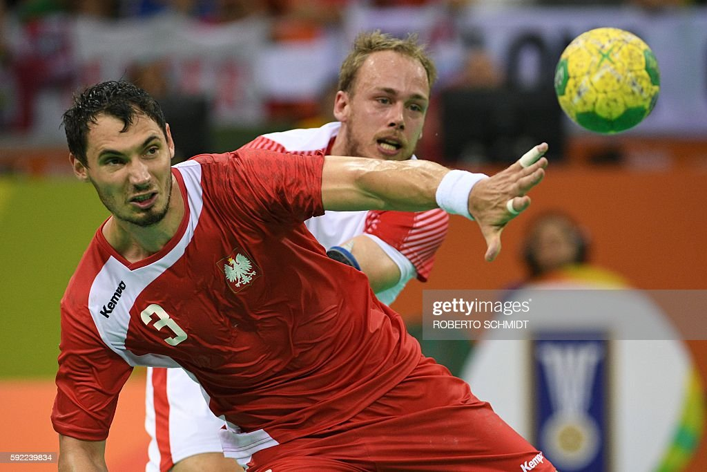 Poland's right back Krzysztof Lijewski shoots during the men's semifinal handball match Poland vs Denmark for the Rio 2016 Olympics Games at the...